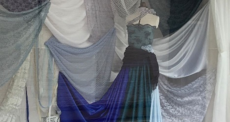 A picture containing person, curtain, indoor, person  Description automatically generated